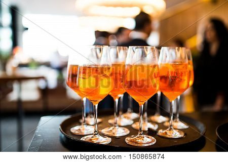 Apero coctails Aperol spritz glasses on tablet