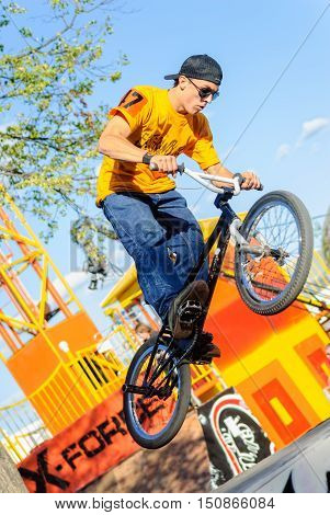 Tyumen, Russia - July 26, 2007: Cvetnoy Bulvar park. Second stage of competitions in extreme sports. Siberian games 2007. BMX rider shows skill