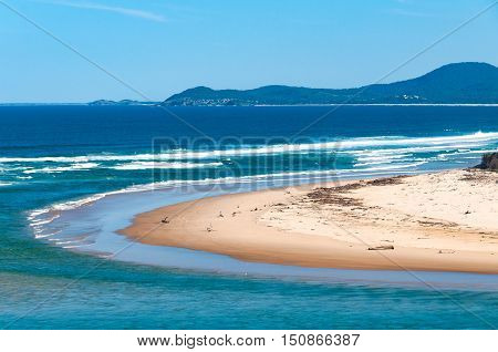 Tropical Sand Beach With Turquoise Water And Blue Sky