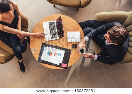 Businesswoman Meeting With Businessman At Office Lobby