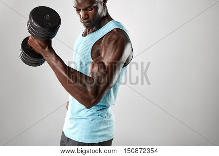 Fit And Young Man Working Out With Heavy Dumbbell