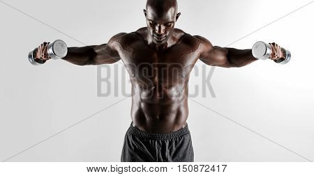 Shirtless Muscular Man Exercising With Hand Weights