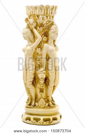 Mystic Candle in the form of female figures with Cerberus at the feet. Carved ivory. Isolated image.