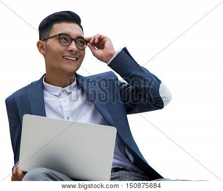 Isolated portrait of Asian businessman holding laptop in his hand and smiling broadly while sitting on chair. Concept of successful entrepreneur. Mock up