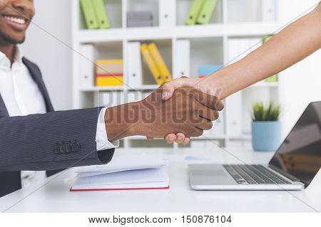 Black Man Shaking Woman's Hand