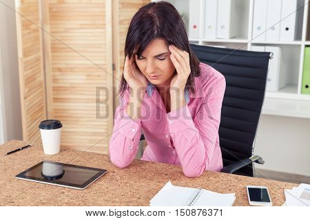 Woman With Headahce In Office