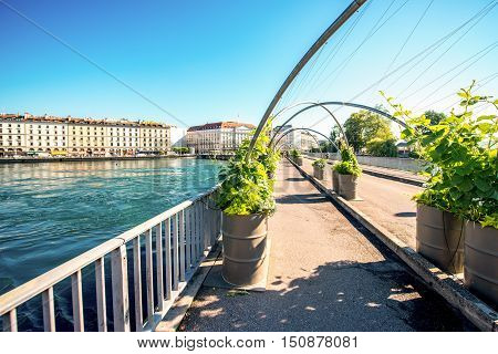 Geneva, Switzerland - June 23, 2016: Bergues pedestrian bridge in the center of Geneva city. Geneva is a financial center and worldwide center for diplomacy in Europe