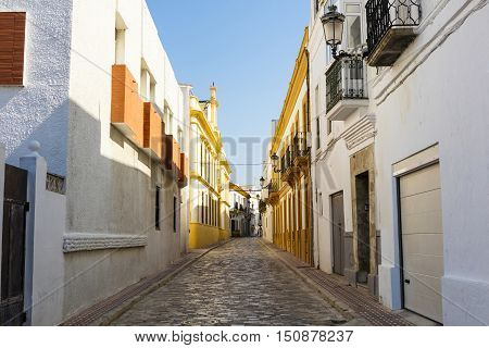 Narrow cobbled street in an old Spanish town.