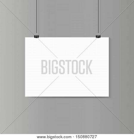Empty horizontal white paper poster mockup on grey wall with paper clip. Vector illustration.