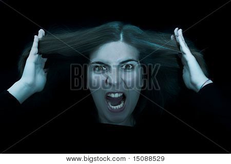 Angry woman grasping is hair