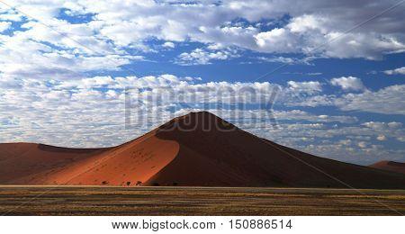 Deep shadows on Sossusvlei dunes at sunrise Namib desert Namibia