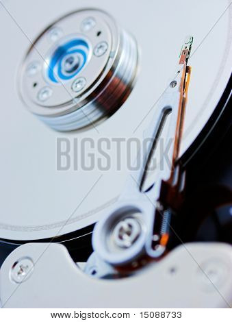 Open hard disk drive, shallow depth of field with focus on the needle