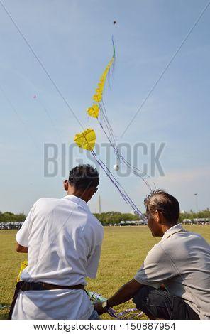 Bangkok Thailand April 20, 2014 men fly long rope kite in Bangkok celebration 232 anniversary at Sanam Laung  Thailand