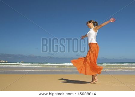 Beautiful woman dancing in the beach