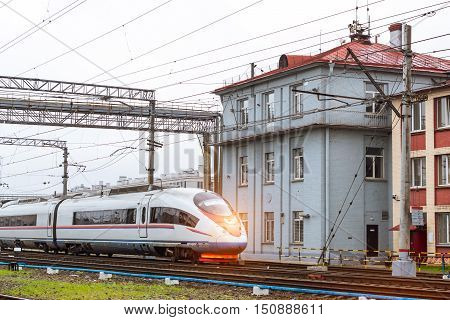 Modern hybrid-electric locomotive Sapsan pulling a high-speed train on rails. Technical railway operational locomotive depot. Transport infrastructure of railways route St.Petersburg - Moscow Russia