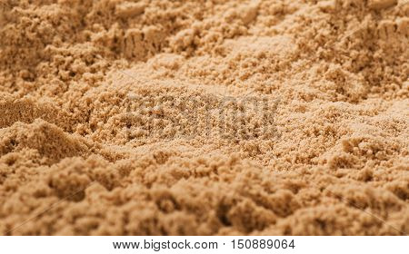 Background made of whey protein with visible texture. Image taken from above, top view