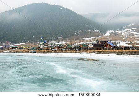 Big Goloustnaya Village. View From Iced Baikal Lake