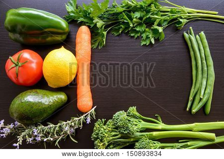 Top flat lay view of fresh organic vegetables on wooden background