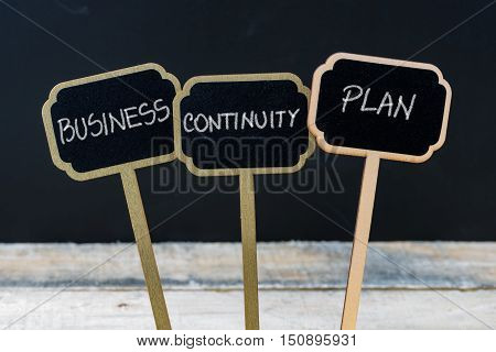 Business Continuity Plan Message Written With Chalk On Wooden Mini Blackboard Labels