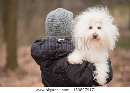 Woman Holding On Her Shoulder Her Puppy