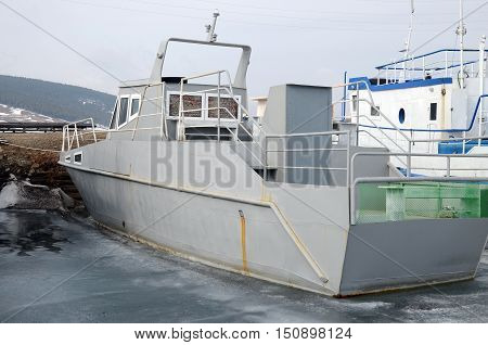 Ship And Fisher Boats On The Dock In Large Goloustnoye Village. Baikal Lake