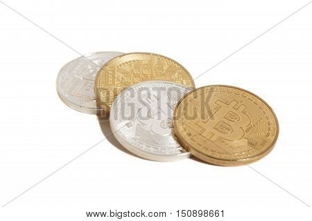 Golden and silver bitcoin coins isolated on white background