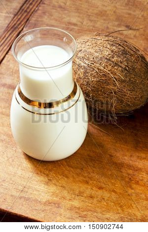 Homemade coconut milk on a wooden table