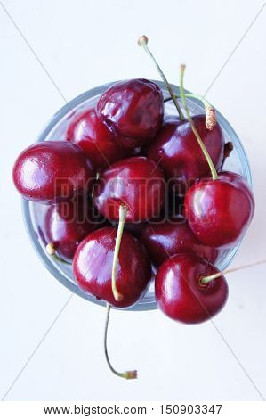 Cherry still life. Bright juicy ripe sweet cherries against a white background.