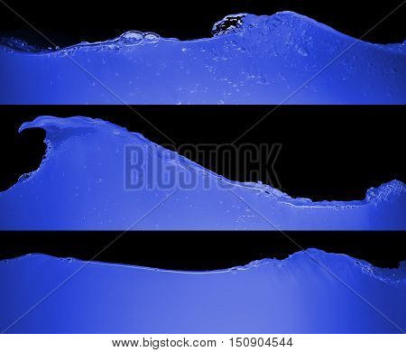 set of blue water waves on black background