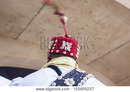 Arabic musician spinning his hat string at the Almossasa Culture Festival