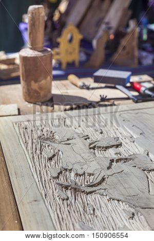 Badajoz Spain - September 24 2016: Craftsman table with tools for engrave wooden crafts