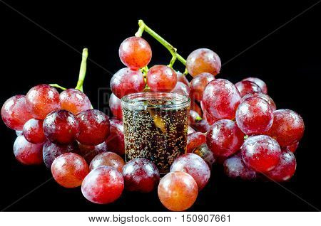 glass of wine red grape isolated on black background
