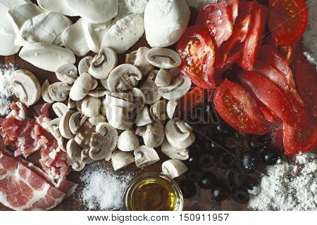 Ingredients for calzone top view mix, red, white, black, yellow