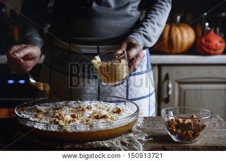 Adding cracker crumbs in the dough for pumpkin dump cake