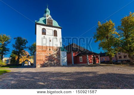 PORVOO FINLAND - October 08 2016: The bell tower of the medieval cathedral in town Porvoo and cathedral cobblestone square Finland