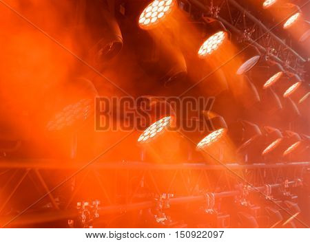 Stage lighting equipment. Concert spotlight. The direct rays of light in the haze.