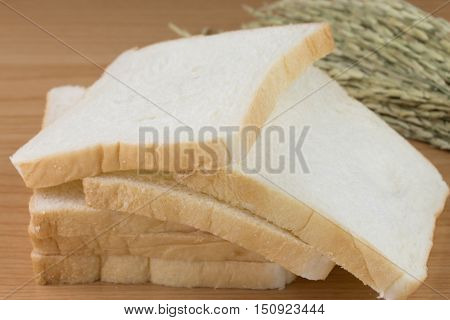 Whole wheat bread on a wooden table.
