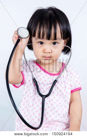 Asian Chinese Little Girl Holding Stethoscope