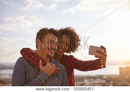 Joyous Young Couple Posing For A Selfie