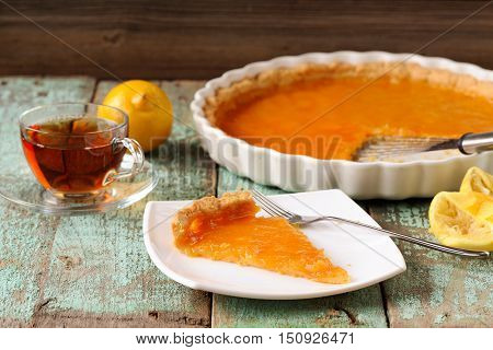 Lemon pie with fresh and squeezed lemon cup of tea horizontal