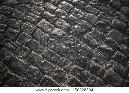 the Dark paving stone roadway black background