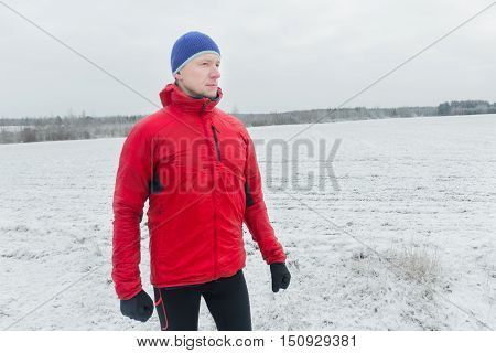 Man wearing protective sport jacket before his winter training session outdoors