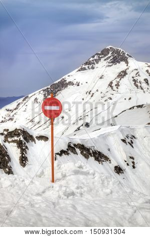 Caucasus. A top of mountain Rosa Plateau. Warning sign about the danger of falling
