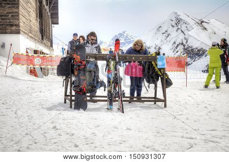 SOCHI KRASNAYA POLYANA RUSSIA - April 29.2015: Place of maintenance of ski equipment. People sort out things in bags and backpacks. Mountain Rose Plateau. Vertex