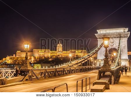 Night View Of The Szechenyi Chain Bridge Over Danube River And Royal Palace In Budapest