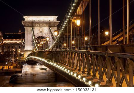 Night View Of The Szechenyi Chain Bridge On The River Danube In Budapest
