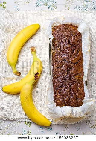 Banana bread with nutella. Selective focus. Style rustic.