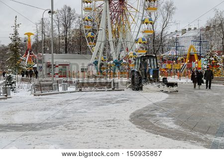 Tyumen, Russia - November 29, 2008: Tractor with snowplowing equipment cleans street in snowstorm weather.