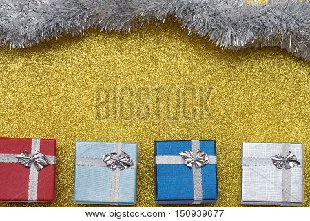 Four Small Box On Yellow Background