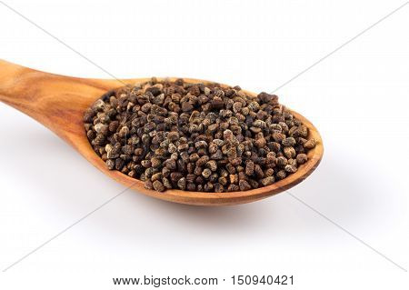 Decorticated Cardamom Seeds In A Wooden Spoon